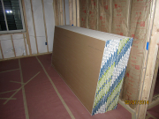 Drywall is stacked in basement