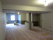 Drywall is hung and floors vacuumed