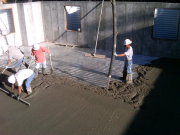 Concrete being poured & finished for structural floor