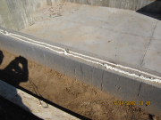 Sill plates set in expandable spray foam for air infilteration control
