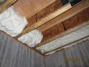 Foam insulation on rim board for air filtration control