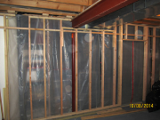 Framed wall with plastic protection barrier in place