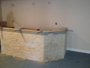 Installing stone of face of bar
