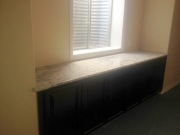 Granite countertop on new cabinets in TV room