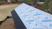 Roof covered with synthetic underlayment