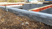 Existing foundation is corrected with structural grout