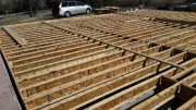 Joists are braced straight before sheathing