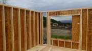Corner OSB overlaps for air seal and strength
