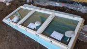 Windows are unwrapped on foam for care in handling