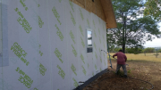 Carlos applying new Grace fully-adhered vapor permeable weather resistive barrier