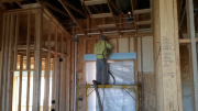 Closed cell foam insulation being installed