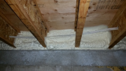 Closed cell foam insulation at rim in basement