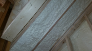 Closed cell foam insulation in full rafter cavities
