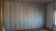 Interior master bedroom wall insulated