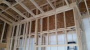 Attic walls are sheathed over insulation