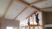 Installing beams in family room and kitchen
