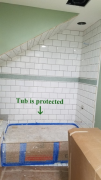 Installing tile in daughters bath. Tub is protected