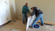 Keith starting underlayment application at brick entry