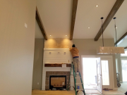 Carlos installing shiplap at fireplace