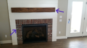 Reclaimed lumber and brick used at fireplace
