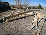 Roof trusses are organized and gables sheathed on ground