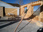 Garage walls are braced before roof trusses are installed