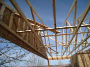 Deck roof trusses and gable are braced