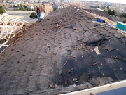 Old cedar shingles are removed