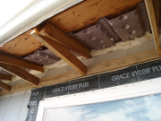 Insulation baffles are installed in original attic space