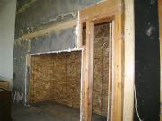Sheathing behind fireplace to hold insulation