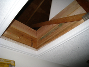 Old attic acces retrofited with insulation barrier