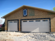 Insulated garage doors are installed