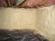 Crawlspace foundation walls are sprayed with foam