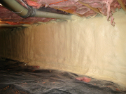 Walls in crawl space are insulated with closed cell foam