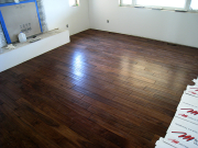 Hardwood floor is finished in living room