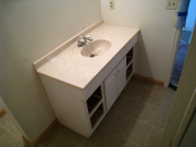 Basement bath existing cabinet  & top are re-installed