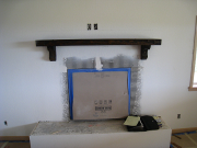 Existing mantle re-installed above new fireplace