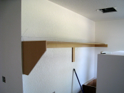 Shelf in laundry above washer & dryer