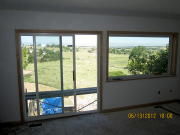 Windows in master bedroom are trimmed