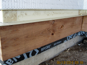 Detail of deck ledger, flashing, foam & lath