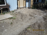 Old front concrete patio is removed
