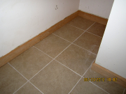 New basement tile & baseboard