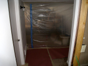 Basement is divided with plastic and zipper door