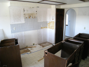 Kitchen cabinets and appliances are removed