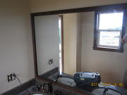 Wood framed mirror installed