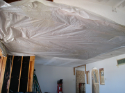 Kitchen ceiling is covered with plastic to keep heat in