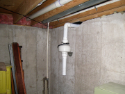 Radon fan is located in existing basement