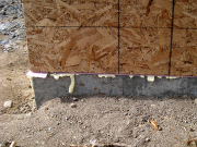 Sill plates are set in foam insulation for air infilteration control