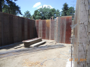 Foundation forms and rebar staged for installation