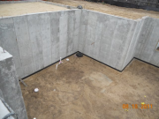 Basement graded and wetted down for slab pour